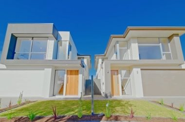 front view of two modern detached homes with front garden